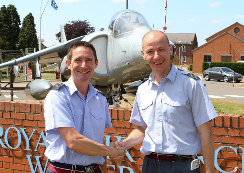 Group Captain Damian Alexander hands over to new RAF Wittering station commander Group Captain Rich Pratley. EMN-151106-164724001