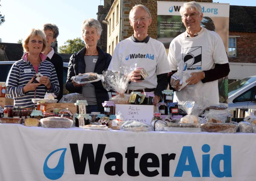 The Rutland branch of WaterAid holds a fundraising stall in Uppingham. Angela Pollard, Hilary Williams, Charlotte Baker, Robert Macleod-Smith, Richard Harris.''Photo: Alan Walters MSMP-26-09-15-aw001 EMN-150110-132739001