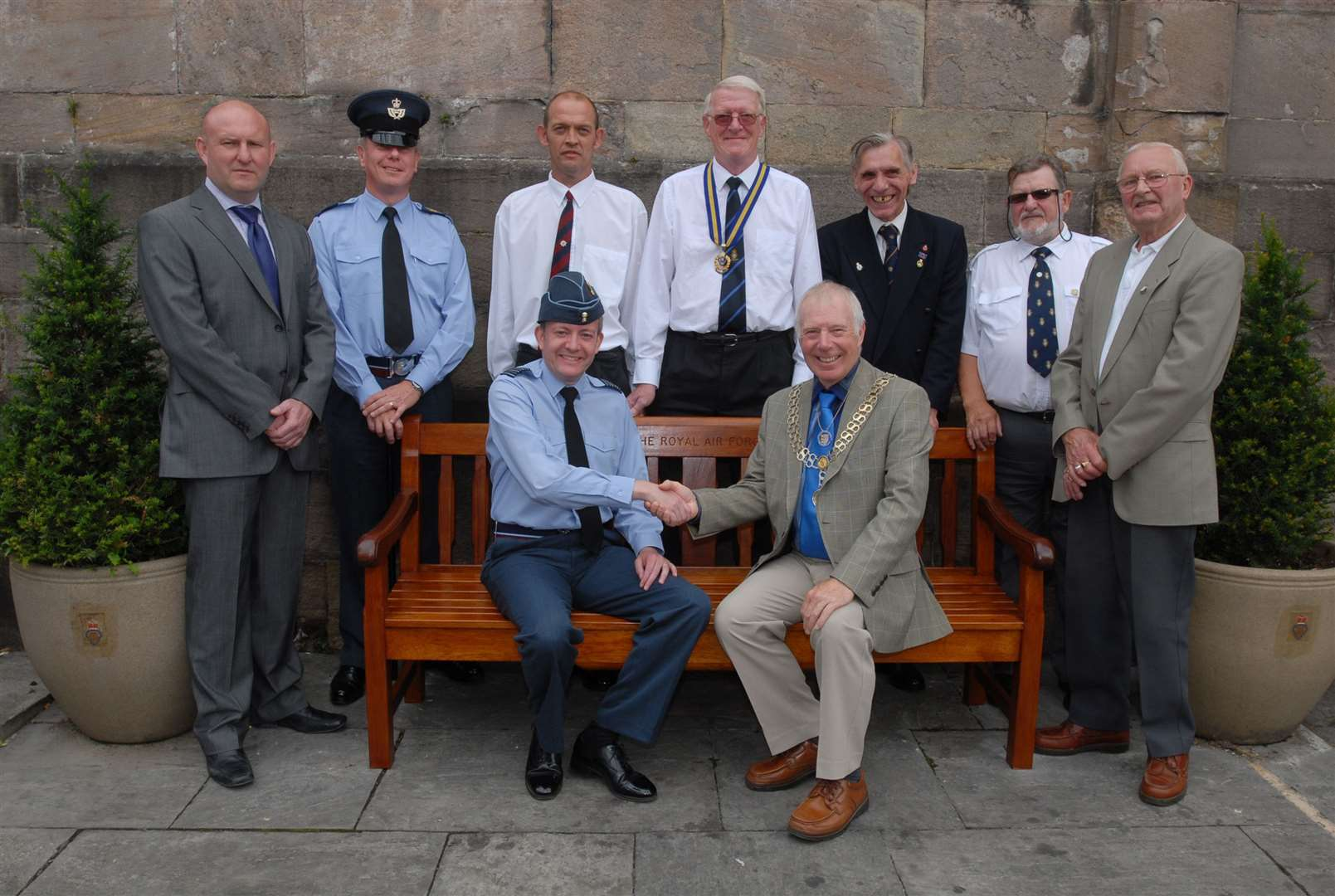 Installation of a memorial bench at Stamford war memorial by RAF Wittering. From left, back, Rik Pepper, WO Steve Poulton, Shaun Arthur, John Copeland, Bill Turner, Ray Beresford, and John Binder. Front, RAF Wittering group captain, Richard Knighton, and former Stamford mayor, David Brailsford.