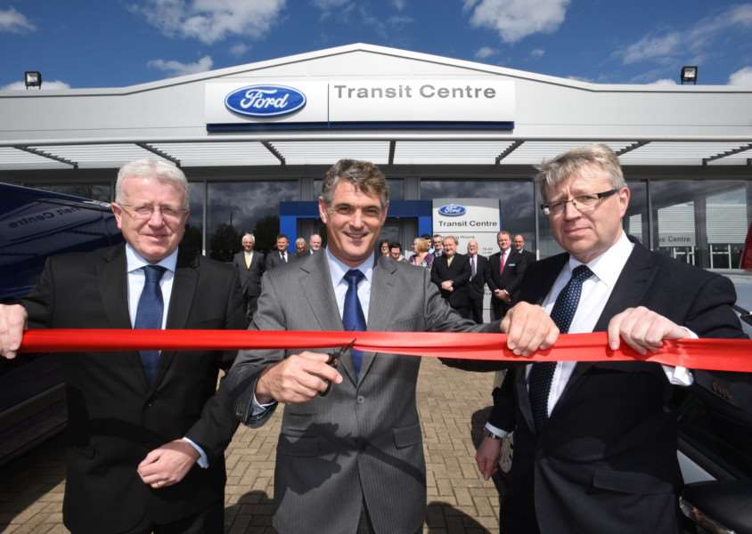 Opening the new centre are, from left, Terry Rayner from Ford, James Harrison, chairman and Billy Fitch, group business centre manager. EMN-150505-182705009