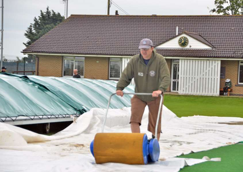 Market Deeping groundstaff get the Outgang Road pitch playable for the visit of Grimsby. Photo: Tim Wilson.