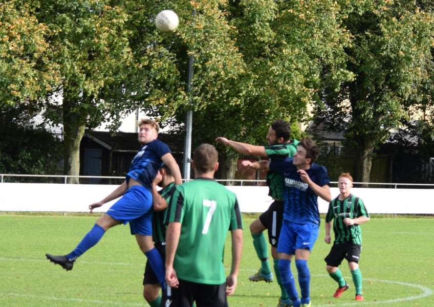Gareth Jelleyman goes up for a header against Lutterworth on Saturday.