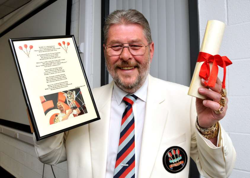 "Three-time world darts champion Martin ""Wolfie""Adams with a framed copy of a specially written photo of him and Honarary Freedom of the Parish certificate. Photo by Tim Wilson."