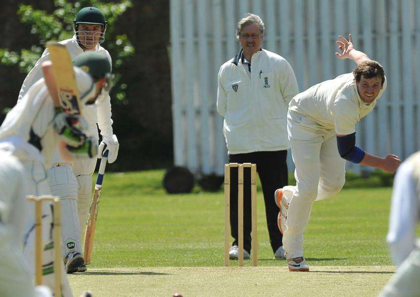 Colin Cheer bowling for Bourne against Woodhall Spa before he left the field win an injury. Photo: David Lowndes.