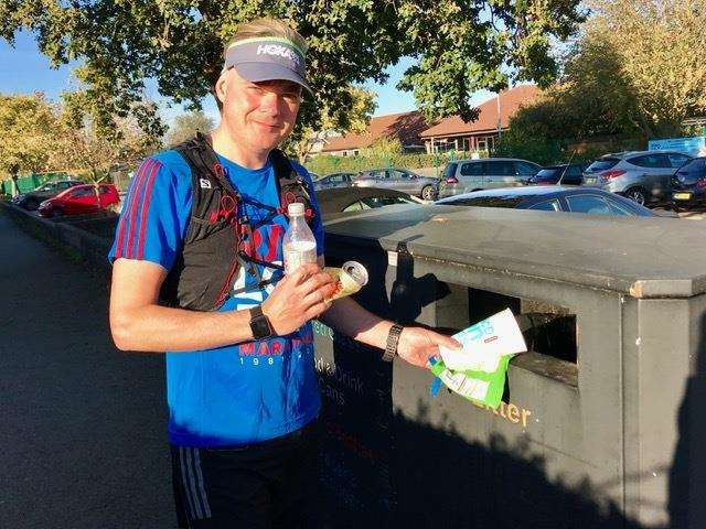 Marathon runner Stephen Gabbutt picks up more rubbish in his clean-up crusade