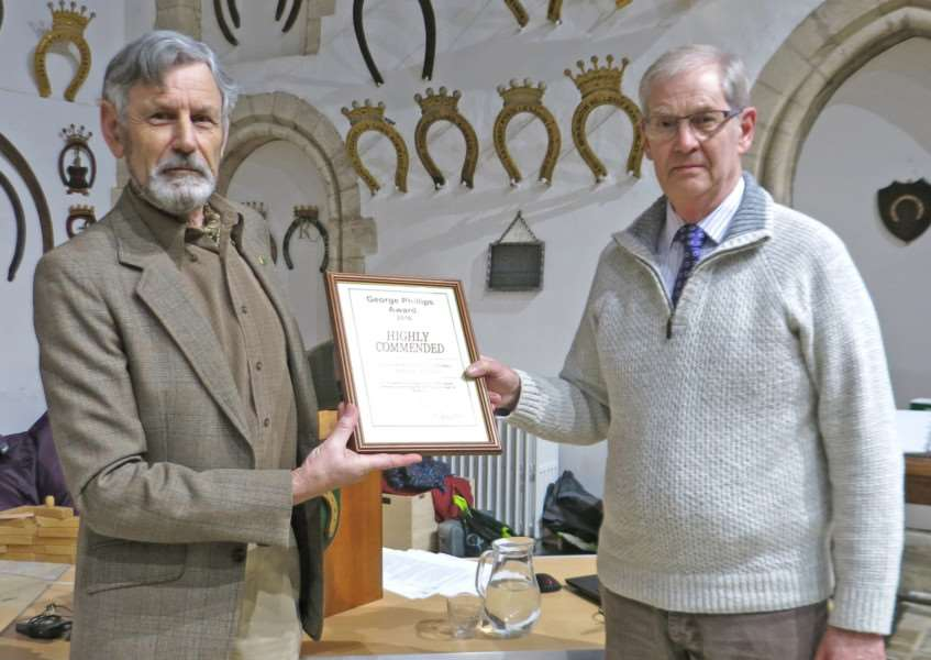 Tim Clough presents a Highly Commended certificate in the George Phillips Awards to David Hearsum for Uppingham School's new Science Centre.