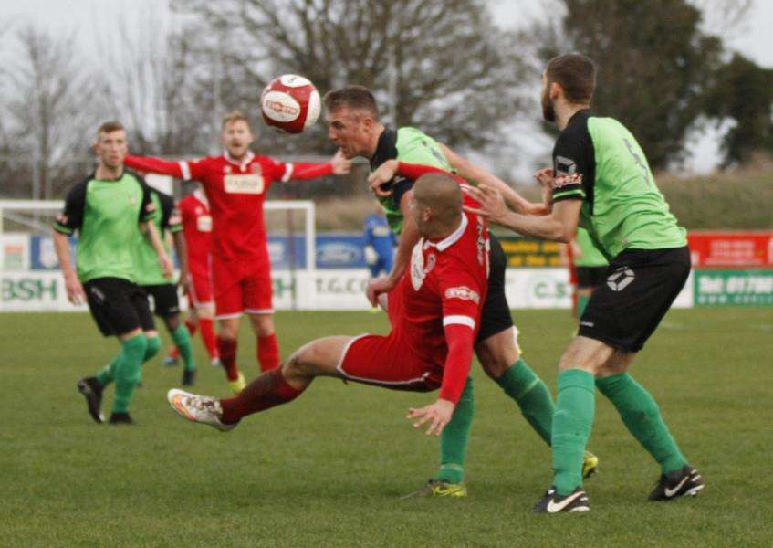 Action from Stamford AFC's home loss to Barwell. Photo: Geoff Atton EMN-151229-103659001