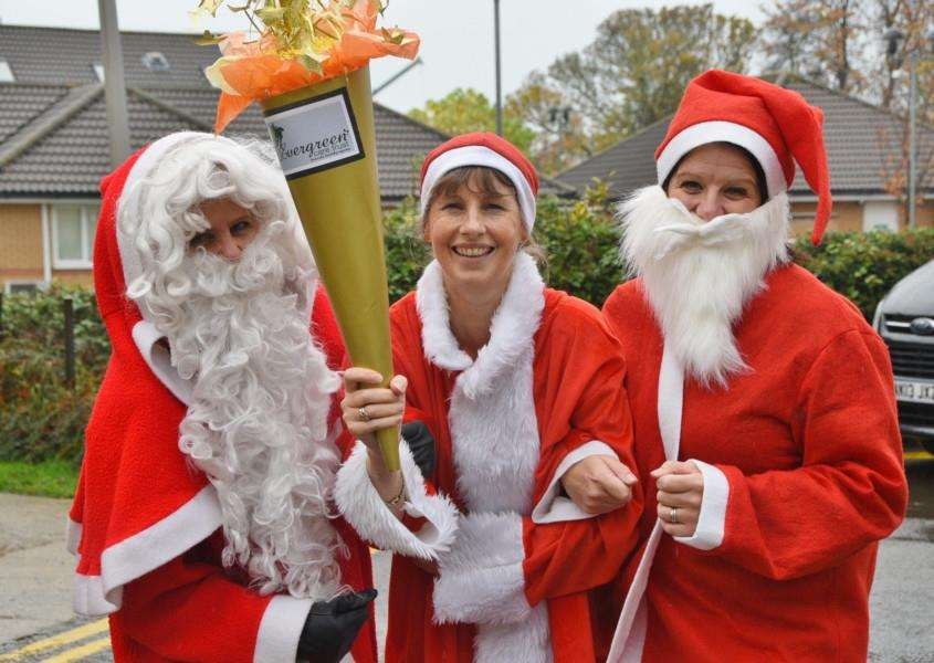 Evergreen Stamford staff Rosie Maclennan, Louise Marsh and Becky Linnell in Santa outfits for their Santa Run event. EMN-150411-165710009