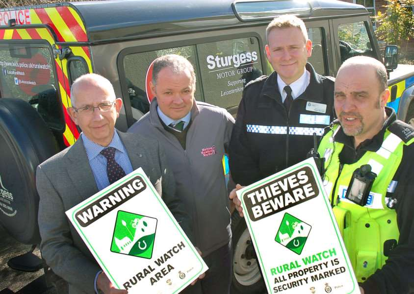 Pictured from left with some of the Rural Watch signs are Stephen Jeal, Melton NFU Mutual senior group secretary, Hugh Brown, cheif executive officer of Gillstream Markets Ltd which manages Melton Market, Leicestershire Police deputy chief constable Roger Bannister and Pc Mark Longden, dedicated neighbourhood officer covering the Vale of Belvoir EMN-160223-175011001 EMN-160223-175011001