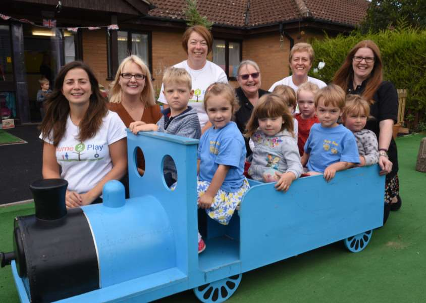 Our picture shows children and staff from Busy Bees with Bourne2Play representatives