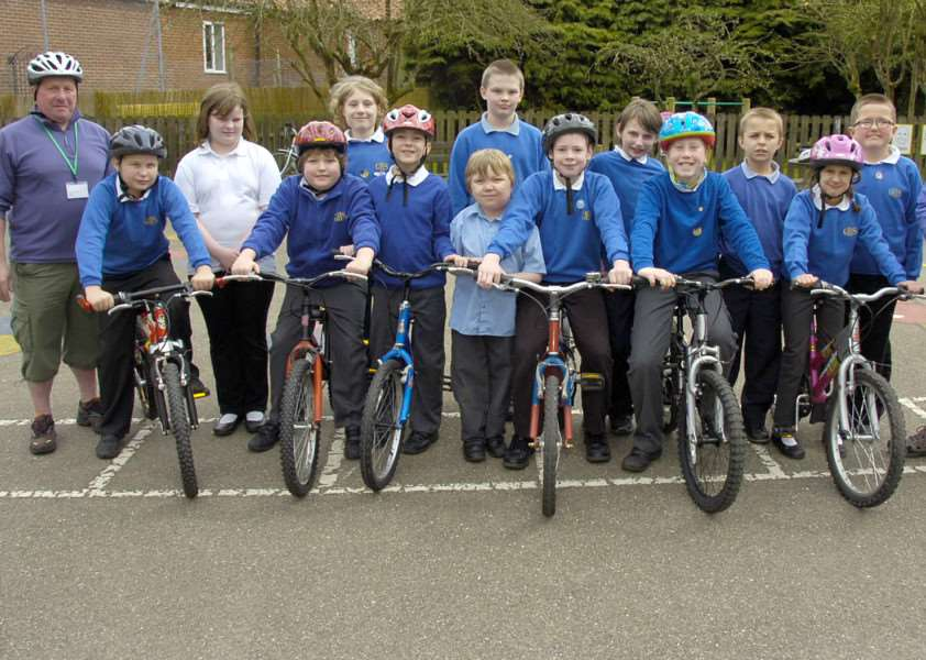 Youngsters take part in a Bikeability course at Gosberton House School with instructors John Levesley (left) and Dennis Ingall. Photo by David Dawson.