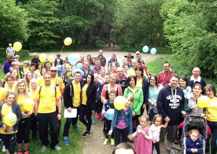 Almost 100 people take part in a walk through Bourne Wood to raise money for the Lullaby Trust in memory of Madaline Dickens, who died of sudden infant death syndrome. EMN-150708-135655001