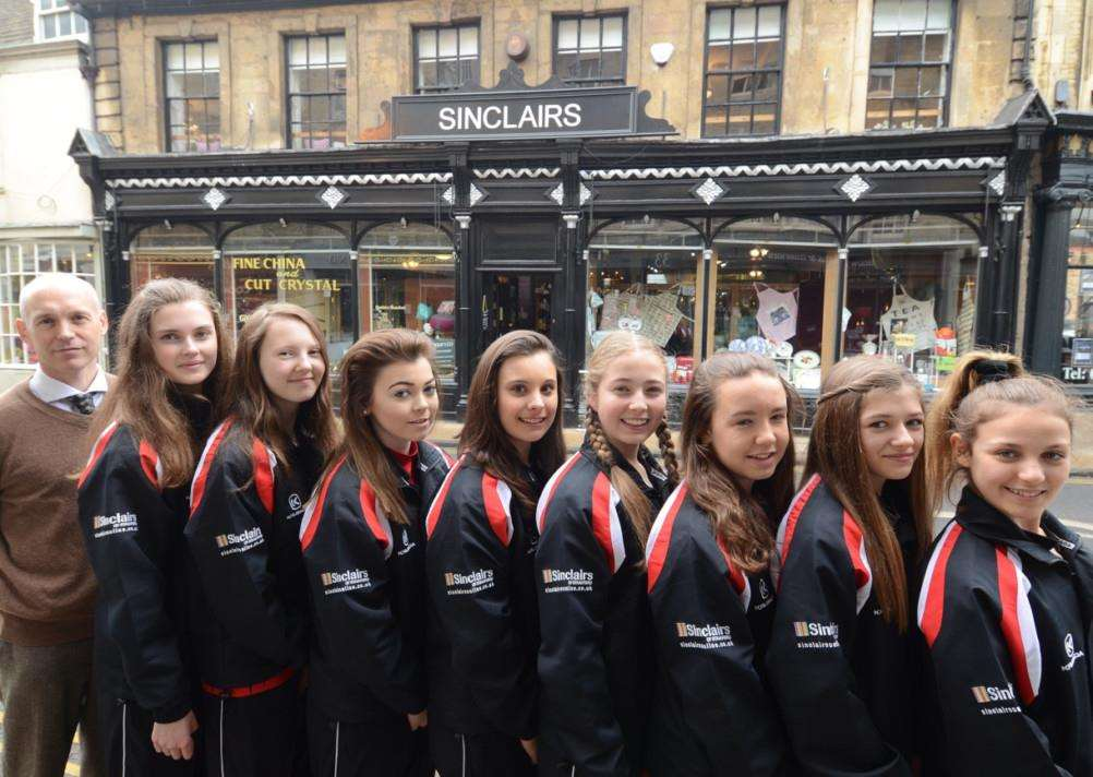 Bourne Grammar U14's netball kit presentation by Cristian Sinclair outside his shop at St Mary's Street, Stamford. Pictured are Julia Eglin, Lily Gray, Sinead Mandy, Chloe Ladley, Lily Storer, Georgia Morton, Polly Luscombe and Gabby Marechal EMN-150317-163831009