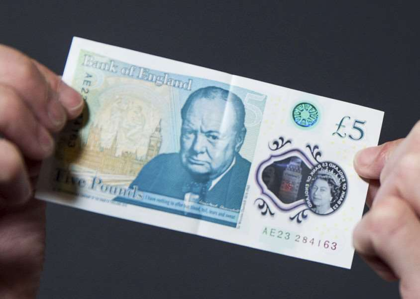 Brits are being urged to check their new fivers after engraved bank notes worth as much as �50,000 were circulated in a Willie Wonka-style 'Golden Ticket' giveaway.