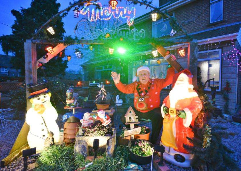 Peter Roff with his Christmas lights outside his house at Langtoft EMN-151212-233349009