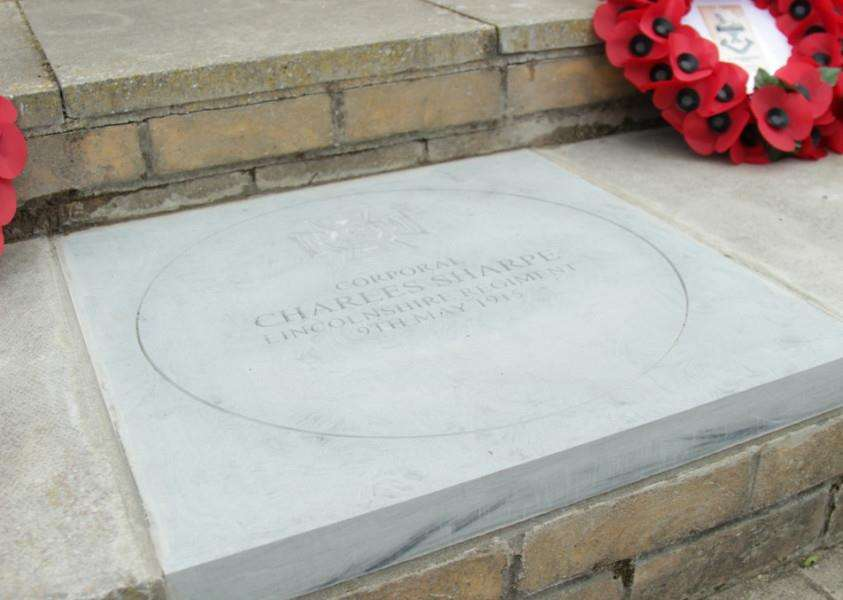 A commemorative stone for First World War soldier Charles Sharpe at the War Memorial in Bourne.