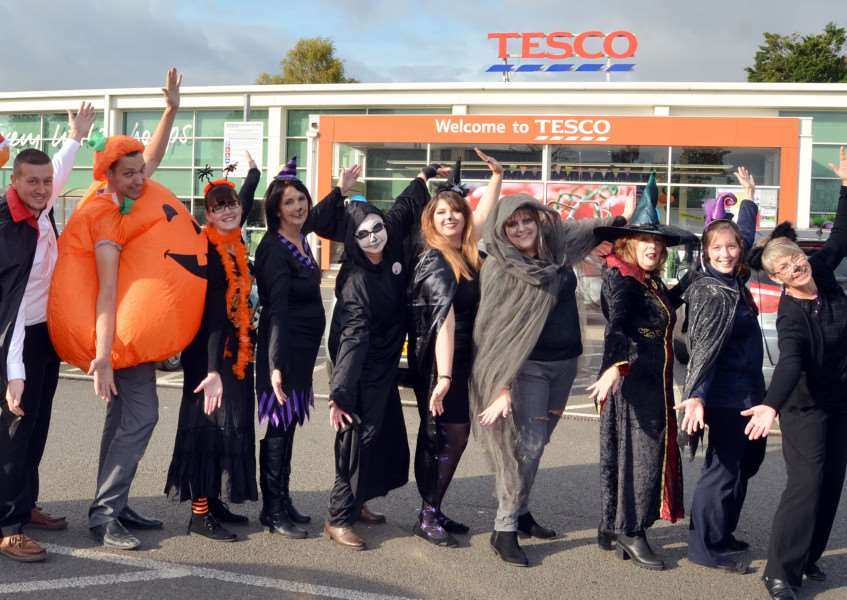 Staff at Tesco Superstore, Holbeach, are swapping thoughts of Halloween for Christmas as they collect small items to fill gift boxes for elderly and vulnerable people across the area. Photo by Tim Wilson.