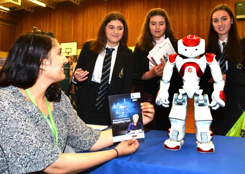 Students Carla Gray, Lauren Cooper and Phoebe Gordon meet Ayisha Mahmood and Pip the Robot from Greater Peterborough University Technical College which is due to open in September 2016. Photo by Tim Wilson.