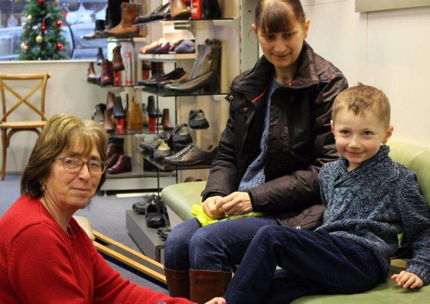 Rosemary Gray helps ensure youngster Callum Elms gets the right footwear