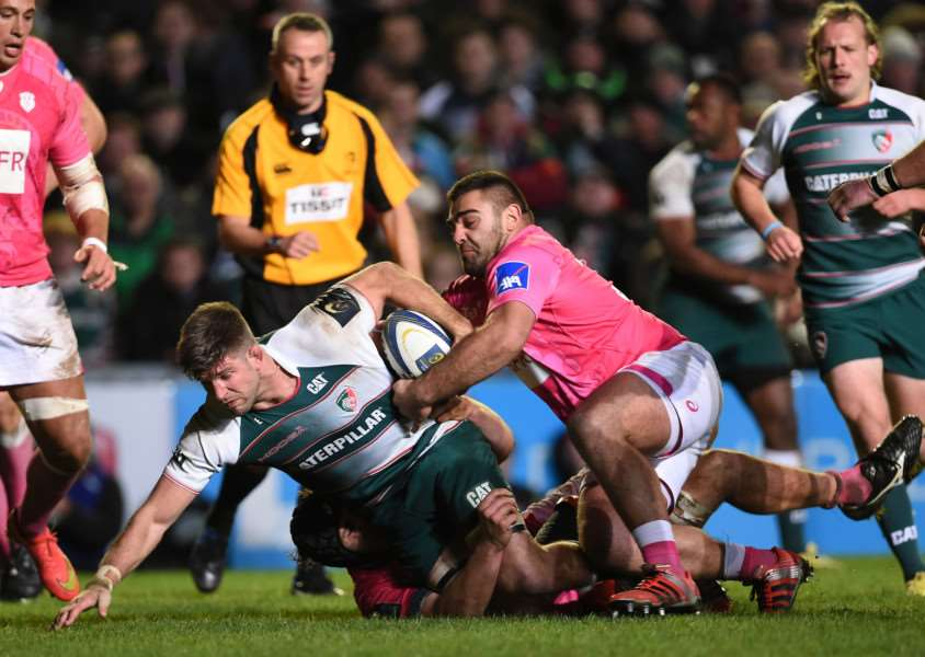 Leicester Tigers' Mike Williams (left) is tackled by Stade Francais' Rabah Slimani and Paul Gabrillagues during the Champions Cup, pool four match at Welford Road, Leicester. Photo: Joe Giddens/PA Wire. EMN-151116-141530001