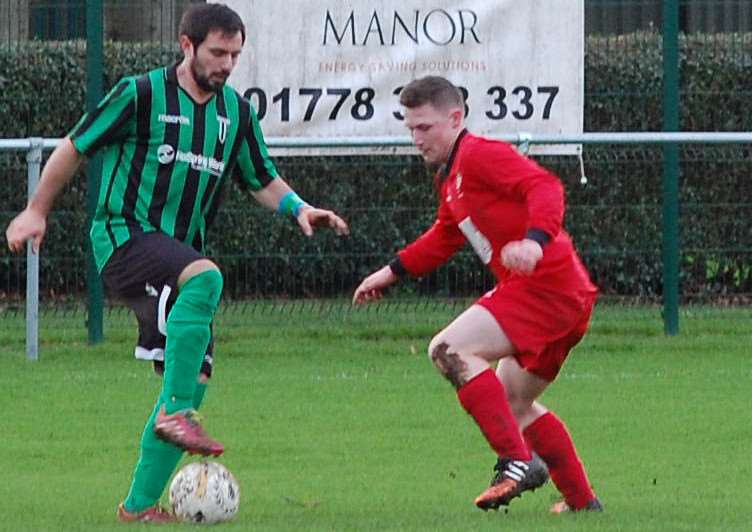 Action from Bourne Town v Blackstones. Photo: Martin Davies EMN-151230-125330001