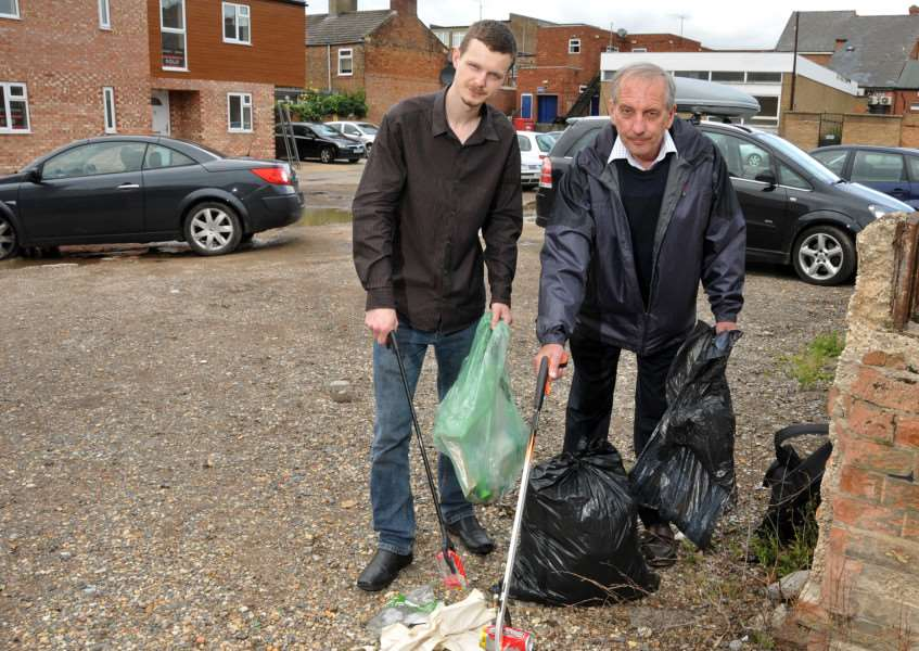 South Holland District Council members Cllrs Jack McLean and Anthony Casson clean up Gore Lane car park, Spalding. Photo by Tim Wilson.