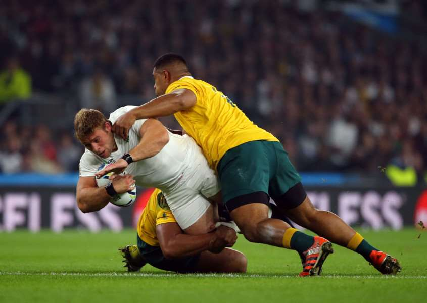 England's Tom Youngs gets tackled by Australia's Scott Sio (right) during the World Cup match at Twickenham Stadium, London. Photo: Gareth Fuller/PA Wire. EMN-150510-143918001
