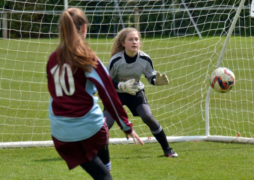 Girls practice their penalty kicks and saves with an eye on getting in the Bourne Town junior team. Photo by Tim Wilson.