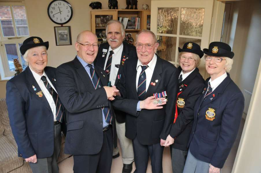 Peter Carpenter (centre right) received the Veterans Star and the Merchant Navy Service Medal last year to add to his wartime honours. SG180115-101TW