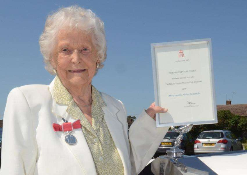 Dorothy Alexander (95) who received the BEM from Lord Lt Toby Dennis at Bourne YC