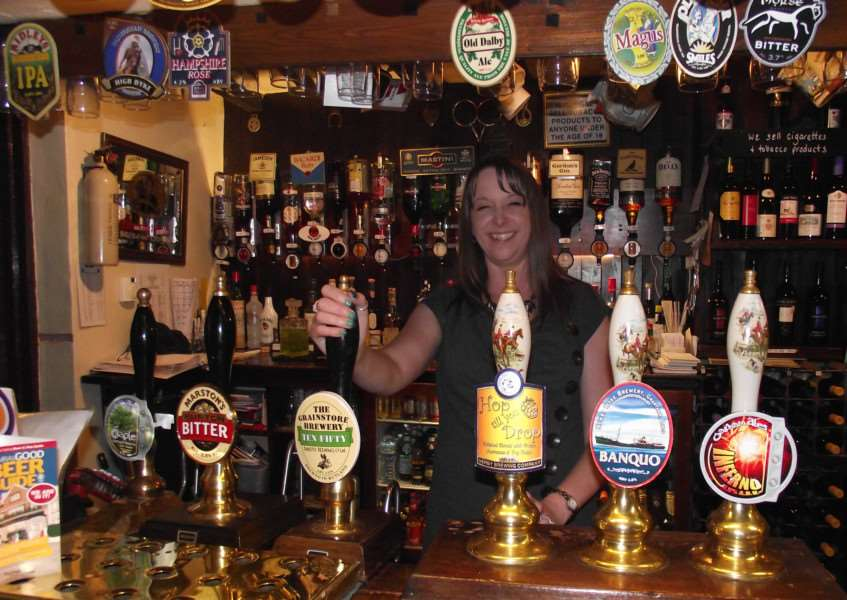 Lynne Bruno behind the bar at the Stilton Cheese Inn at Somerby EMN-150520-201246001