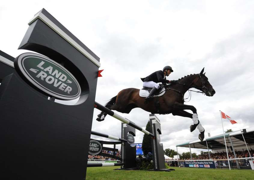 "Jonathan ""Jock"" Paget riding Clifton Promise to victory on the showjumping at Burghley Horse Trials 2013. Photo by Trevor Meeks."
