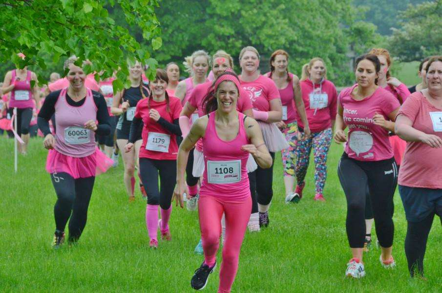Runners in the Race for Life Pretty Muddy event at Burghley Park. EMN-160406-203724009