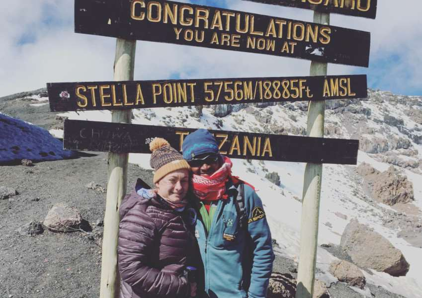 Amy Valentine on top of Kilimanjaro