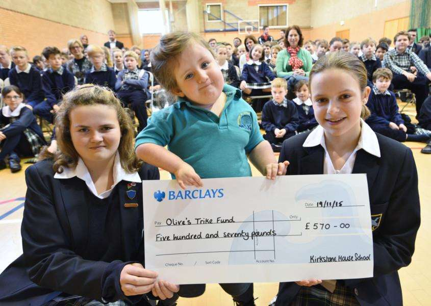 Madaleine Lindsay and Alexi Winship, students at Kirkstone House School, baston presenting a cheque to Olive White following fundraising at the school EMN-151120-105422009