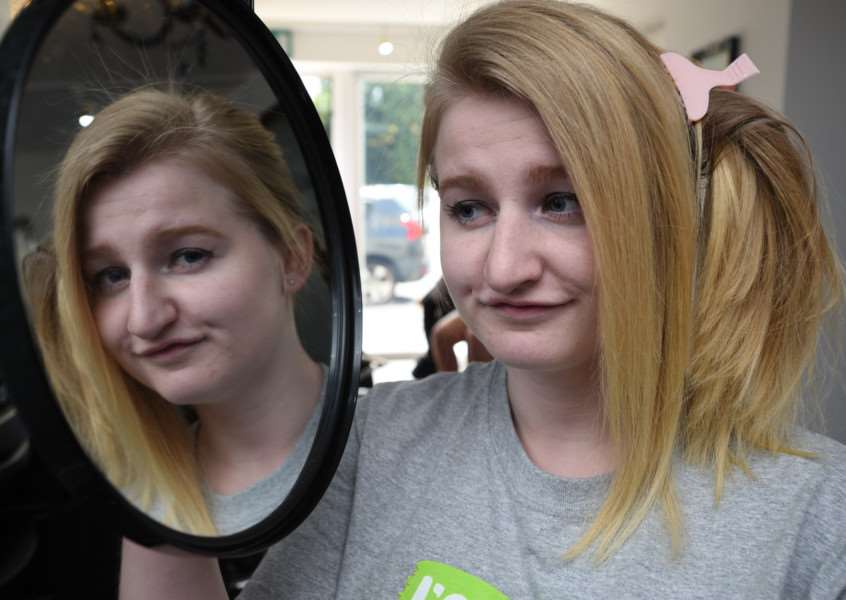14-year-old Sophie Yuill (please check) having half her head shaved at Market Deeping. EMN-150815-181517009