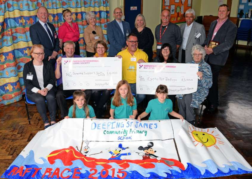 Members of the Deepings Raft Race committee hand over money raised at the 2015 event to Dementia Support South Lincs and the Exotic Pet Refuge.''Back, from left, Bruce Tokens, Tracey Hollis, Pauline Redshaw, Steve Gilbert, Judy Steven, Michael Cerslake, Amrit Mistry, David Milner Scudder.'Front, Naomi Hand, Alan Bulmer, Janet Bird, Kevin Barber, Pam Mansfield, Janet Barber.'Kneeling with the winning banner, Erin Fisk, Emily Lyden, Madison Rees.'Photo: David Pearson EMN-151018-163811001