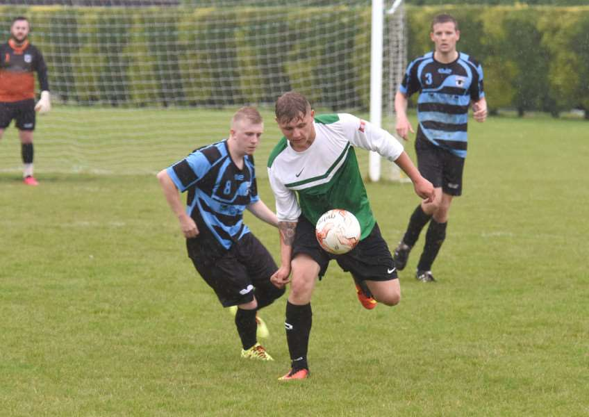 Leverton's Damian Gibbons and Danny Miller of Pointon in action.