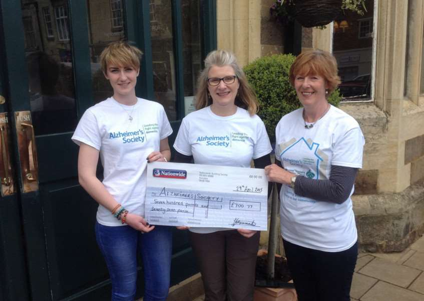 Ella Steward, volunteer for the Alzheimer's Society, receiving a cheque for �700.77 from Ad�le Ginn and Linda Hanraads outside the Falcon Hotel in Uppingham.
