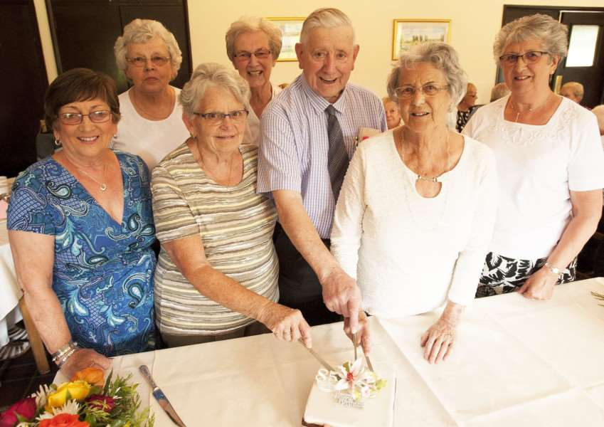 Deepings Forget Me Not Club celebrates its 32nd anniversary at Spalding Golf Club where (from left) June Wright, Thelma Beeton, Sheila Wilkinson, Janet Herd, Angela Bracewell, George Allen and Lillian Derrick cut the club's anniversary cake. Photo by Michael Fysh. SG230717-045MF.