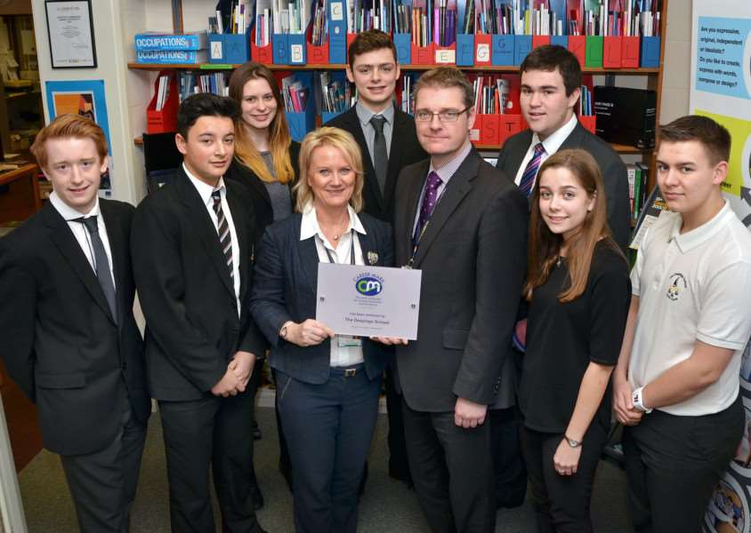 Students at The Deepings School with headteacher Richard Trow (front third right) and careers manager Linda Taylor (third left) with the Career Mark Award. Photo by Tim Wilson.