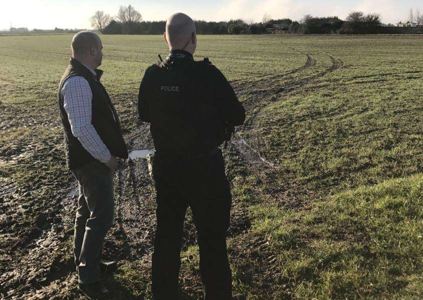 RURAL CRIME: Police and Crime Commissioner Marc Jones (left) and a police officer from Operation Galileo inspect the damage caused by suspected hare coursers in South Holland on Friday. Photo supplied.