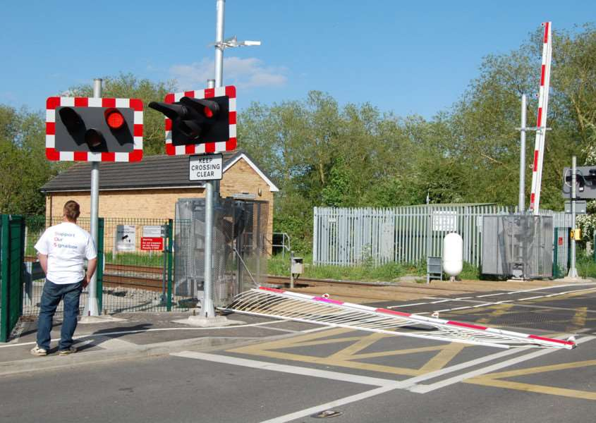 A barrier at the level crossing in Station Road, Deeping St James, was damaged after a vehicle drove into it on May 16, 2015. Photo: Stuart Hall. EMN-150518-103702001
