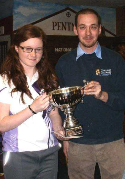 SHINING GEM: Ruby Hill wins the 2014 Pentney Bowls Club youth tournament and is presented with her trophy by Neil Patrick of NK Patrick Electrical, Norfolk.