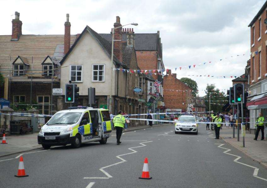 High Street in Oakham is closed after a boy was hit by a car. Photo: Martin Brookes. EMN-150308-153109001
