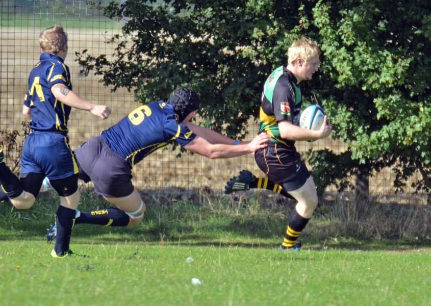 TRIED AND TESTED: Skipper for the day Steven Corrigan runs into the corner for Deepings' only try. Photos (TIM WILSON.