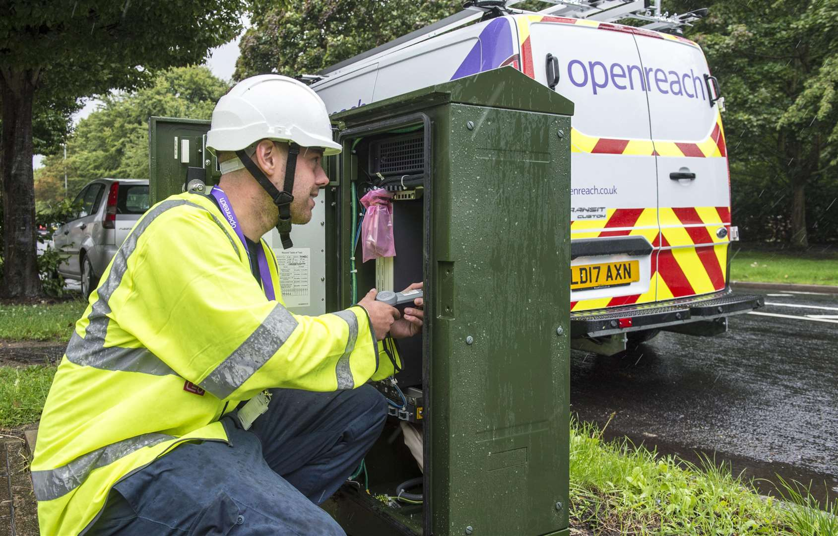 A BT Openreach engineer working on broadband connection (7510472)