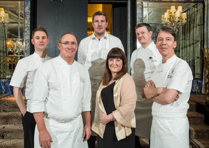 Kellie Charge with head chefs at her children's liver disease foundation meal EMN-150427-110134001