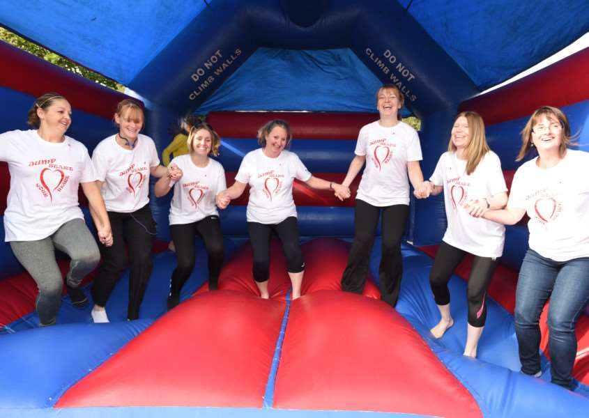 Jump Start your Heart event at Bourne Fire station. Jo Cole with her friends doing a sponsored bounce EMN-150410-150756009