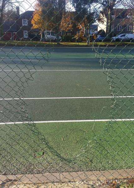 Some of the damage caused - a hole in the fence at the tennis courts